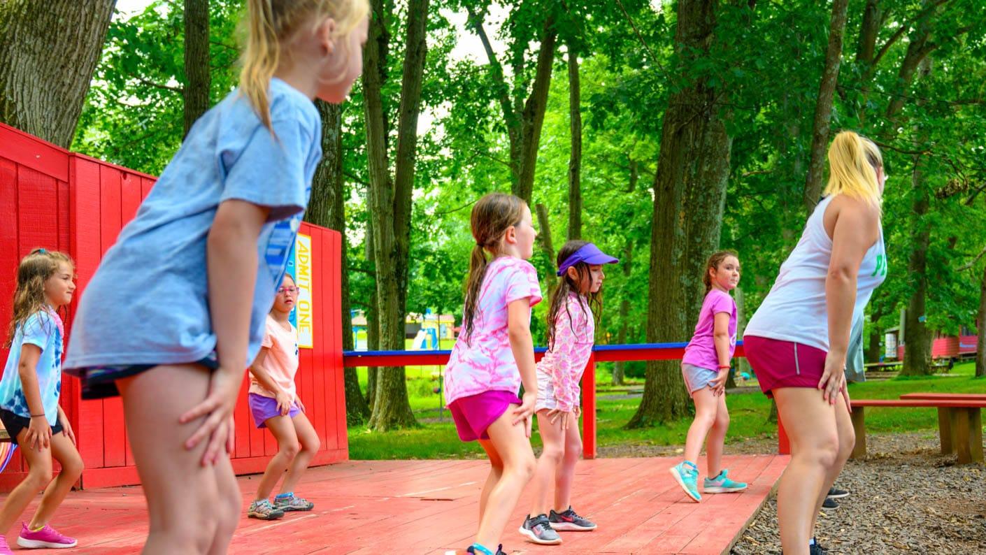 Counselor teaching girls how to dance