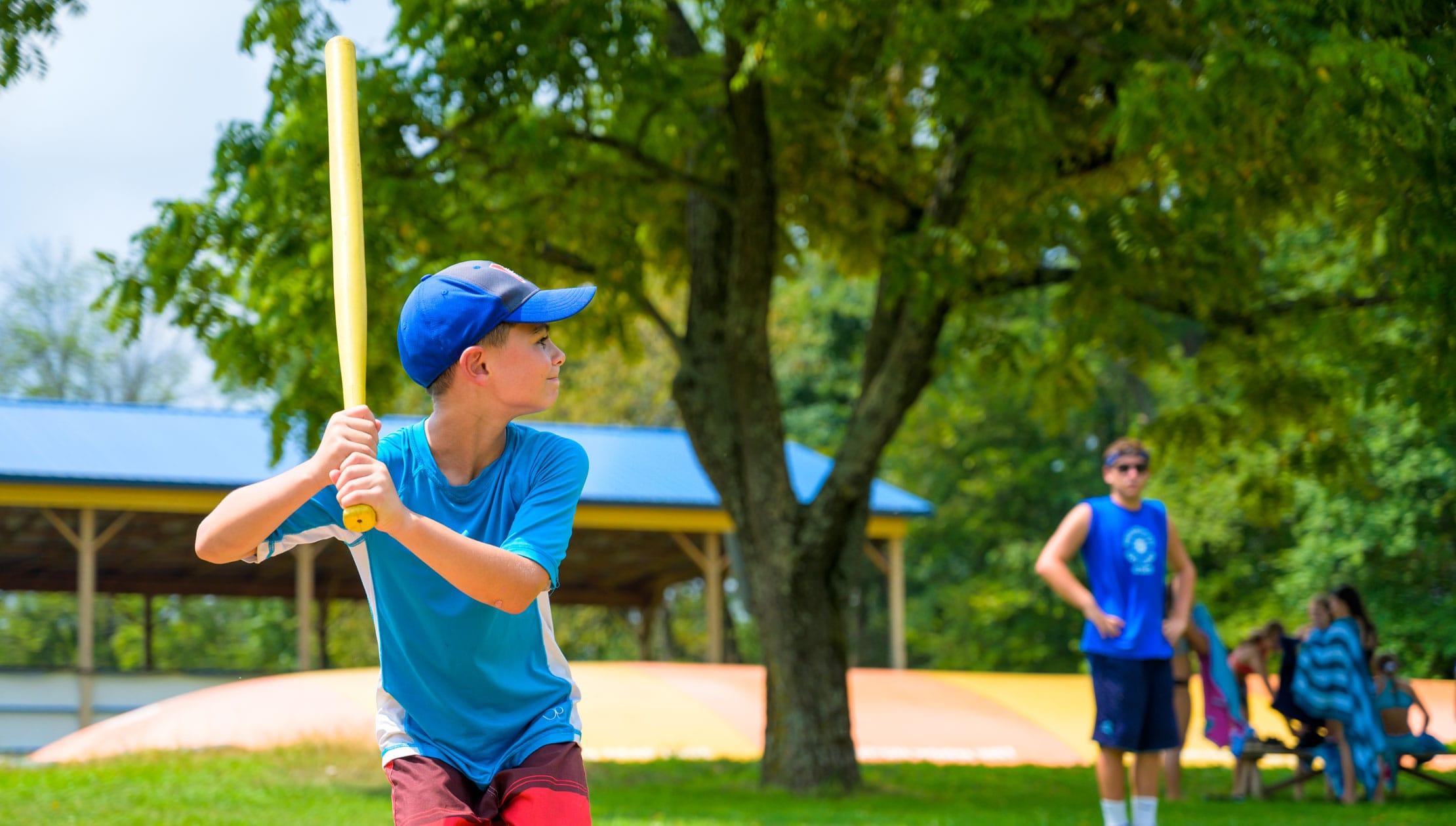 Camper swinging baseball bat