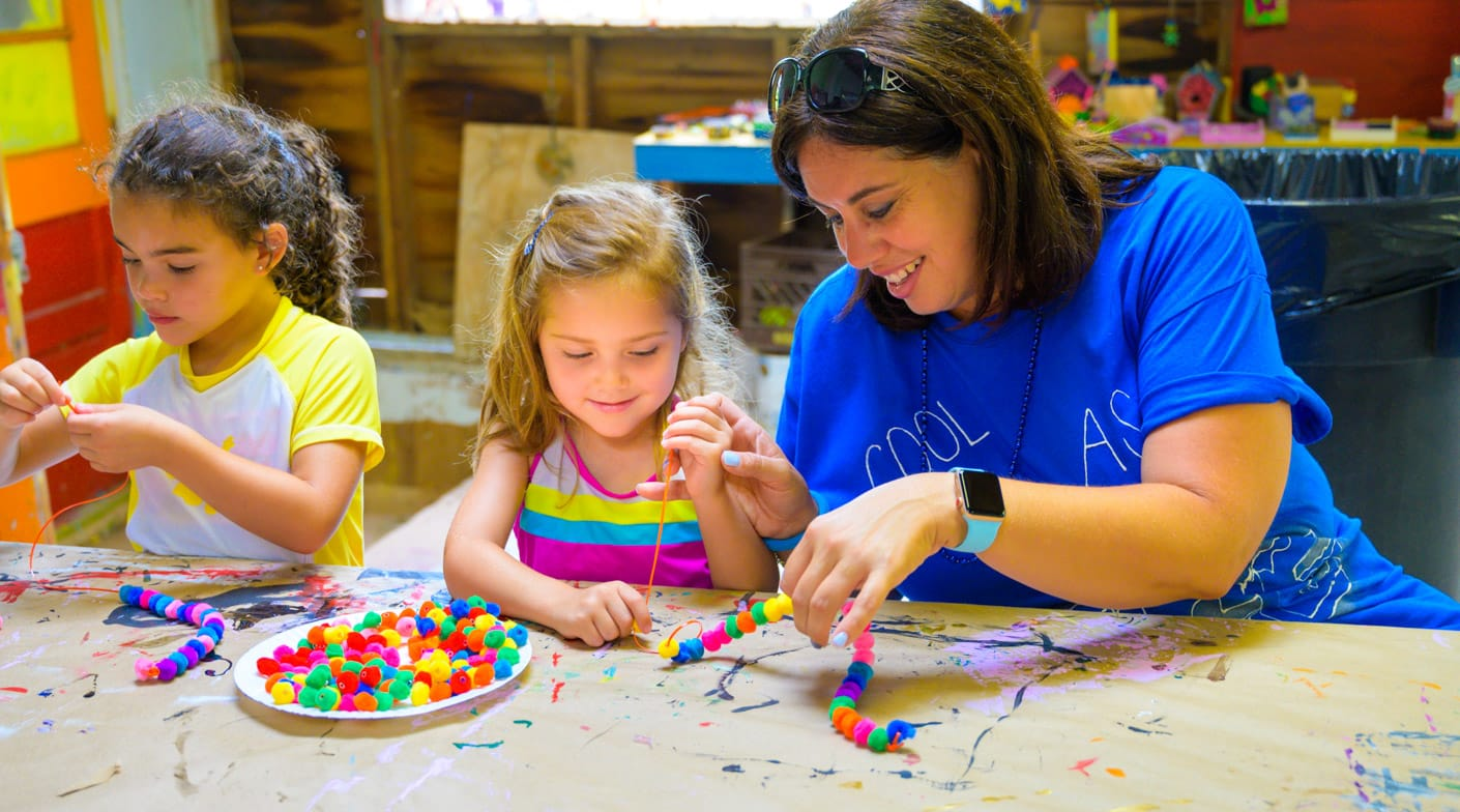 Girls making jewelry
